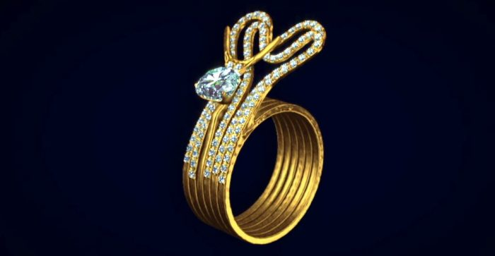 3D model of a tripart gold ring with diamonds in the shape of a snail and heart